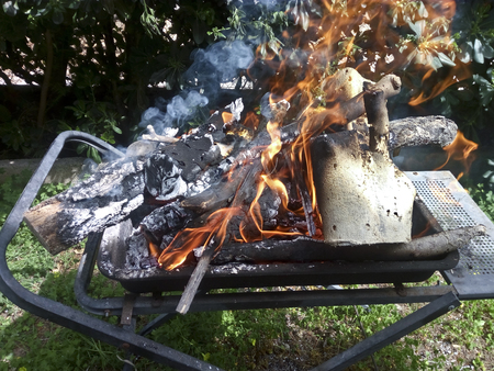 Preparing fire for a BBQ Imagens