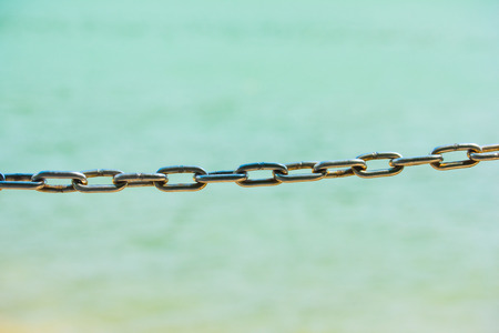 Chains with sea background
