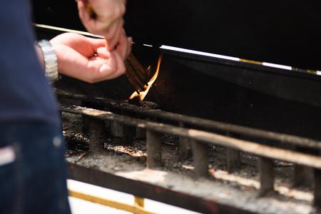 Worshiper Lighting incense in Wong Tai Sin Stock Photo