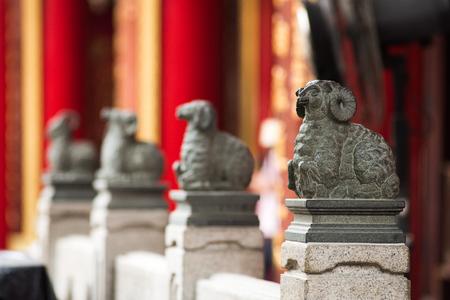Sheep sculpture decoration on railing Stock Photo