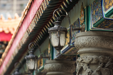 Dragon sculpture on stone pole in Wong Tai Sin