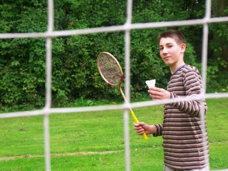 tenager: boy playing badminton