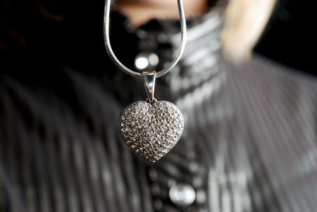 jewell: silver heart on chain