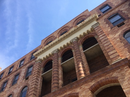 architecture: Old brick building against blue sky