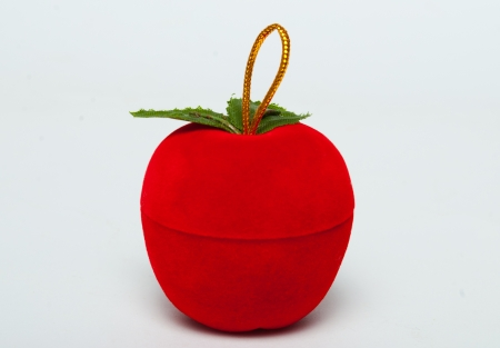 red apple, jewelry box, white background photo