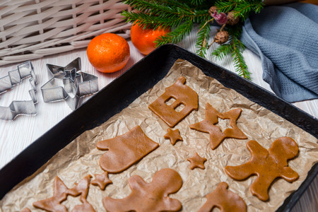 Christmas food, vintage baking tray and gingerbread cookies Stock Photo