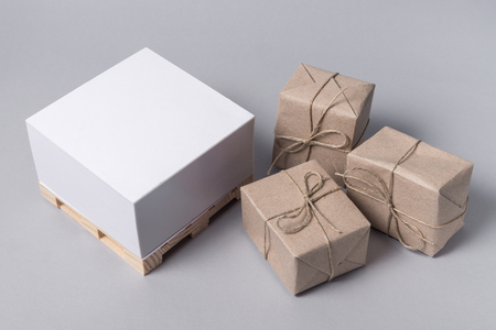 Small pallet and package boxes on gray background, Cargo freight ship, Logistic Import Export concept