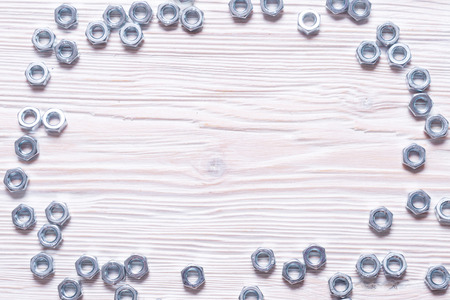 Building bolts on a wooden background