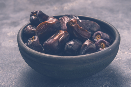 Black dates healthy dried fruits Stockfoto
