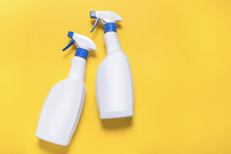 Two plastic bottles with spray