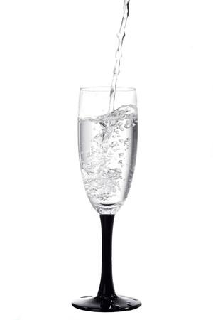 flowing liquid in wine glass photo