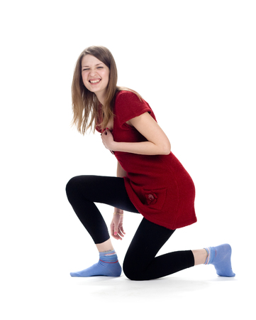 outrage: Laughing woman standing on one knee