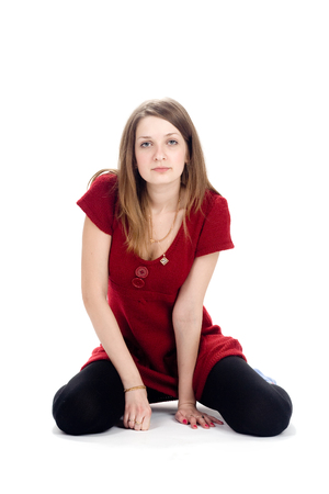 outrage: A serious woman in a red sweater. Looking straight at you Stock Photo