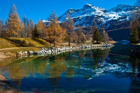 Autumn reflections on the lake Silvaplana - Switzerland photo