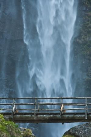cascades: wooden bridge near the waterfall Froda - Sonogno, Switzerland