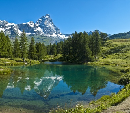 the Matterhorn reflected in the clear waters of blue lake, Valtournenche - Aosta Valley Stok Fotoğraf
