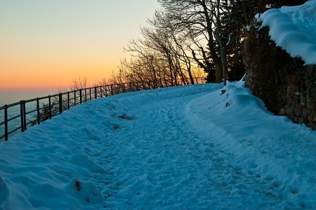 snowy path in the twilight of the winter evening photo