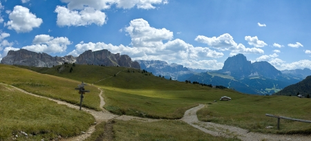 Overview of Mount Stevia and the group of Sassolungo taken from the mountain path of Seceda, Dolomites - Italy