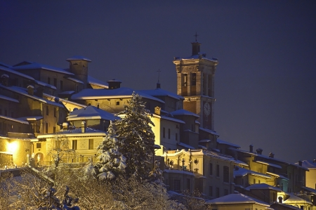 snow on the old town in the mountains at the twilight photo