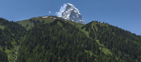 hillsides: The top of the Matterhorn with the hillsides of the valley of Zmutt