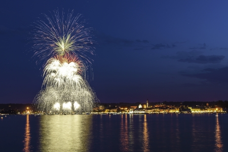 arona: Fireworks on the Lake Maggiore in a summer night, Arona Stock Photo