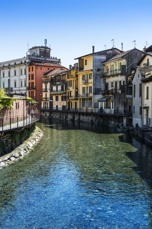 foreshortening: a foreshortening of Omegna, between houses and the river