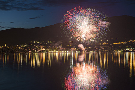 Fireworks on the Varese Lake in a summer evening, Gavirate - Varese