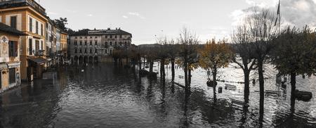 orta: Lake Orta overflow in square of village, autumn season - Piedmont, Italy Stock Photo