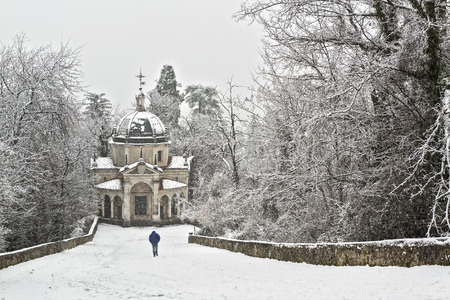 men s feet: Man walking on the path in a snowy afternoon, Sacred Mount of Varese