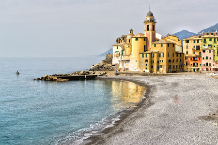 panoramic beach: View on the promenade of Camogli in a spring cloudy morning