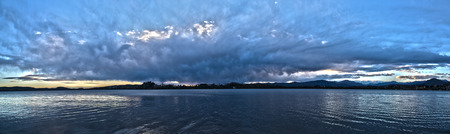 dramatic sky: Landscape on the Varese lake with dramatic sky at the sunset, Voltorre di Gavirate - Lombardy, Italy Stock Photo