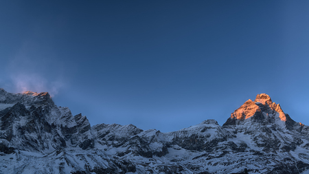 Last rays of sun on the top of the Mount Cervino in winter season, Aosta Valley - Italy 版權商用圖片