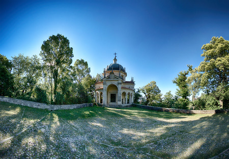fifth: fifth Chapel on the sacred way of the Sacred Mount of Varese in a limpid summer morning, Lombardy - Italy Stock Photo