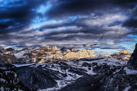 last sunny lights of the day in a beautiful sunset over the mountains of Alta Badia, Trentino-Alto Adige - Italy