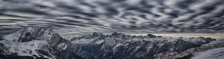 landscape from Sella pass in a winter afternoon and the wind plays with the clouds Archivio Fotografico