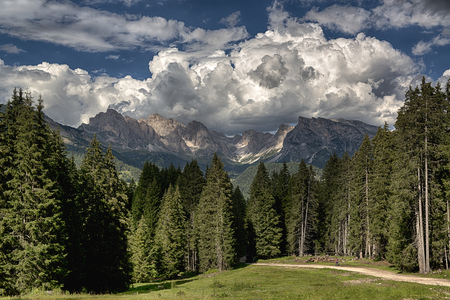 Summer landscape in the italian alps with clouds over the Odle mountains, Dolomiti - Trentino-Alto Adige