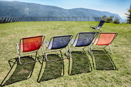 Five deck chairs on the terrace with panoramic mountain views