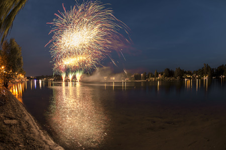 Fireworks on the river Ticino in a summer evening with landscape in the background, final of the show