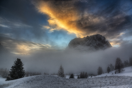 misty hills and sunset over the dolomites
