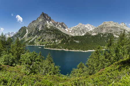 Devero Alp and lake Codelago in a beautiful day of summer season with blue sky in background, Piedmont - Italy