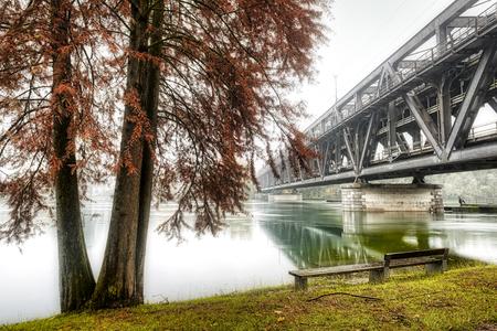 iron bridge on Ticino river in flood during the rainy season Standard-Bild