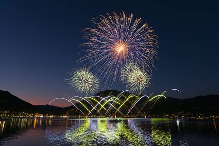fireworks on the Lugano lake in a beautiful summer evening