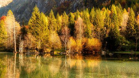 lake in the mountains in autumn season