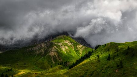 Rays of Sun over the mountains with storm clouds in the sky