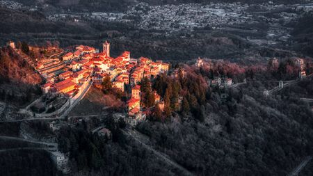 small ancient village of Sacred Mount of Varese illuminated by the setting sun