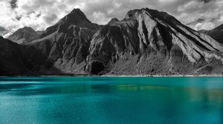 Black and white mountains landscape and beautiful turquoise colors of Morasco lake, Piedmont - Italy