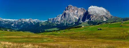 Great landscape of Alpe di Siusi in summer season with snow on the top of mountains, trentino-Alto Adige, Italy Archivio Fotografico