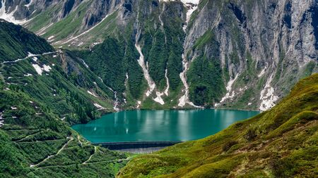 Dam and Lake Morasco in the upper Formazza Valley, aerial view on a sunny summer day 版權商用圖片