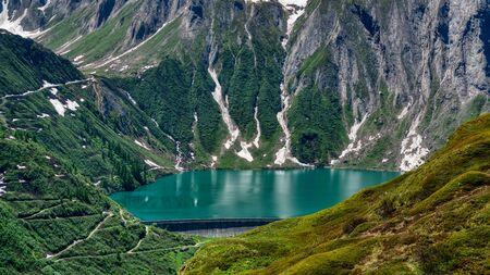 Dam and Lake Morasco in the upper Formazza Valley, aerial view on a sunny summer day Archivio Fotografico
