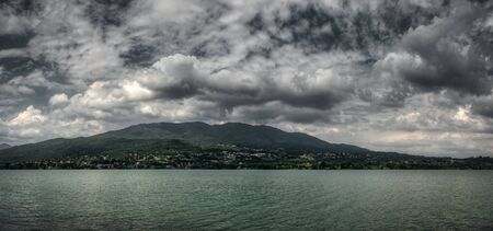 Cloudy sky over the lake of Varese in a spring afternoon